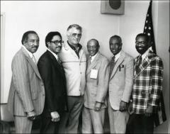 Thumbnail of Jesse Owens poses with Henry Dawkins, Ross Miller, Ken Carpenter, Mack Robinson and Ulis Williams, 1970s