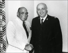 Thumbnail of Jesse Owens poses with Major Ernest Payton of the Salvation Army, 1979