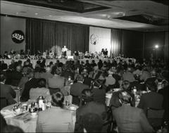 Thumbnail of Jesse Owens speaks on stage at the NCAA Honors Luncheon in San Francisco, 1974