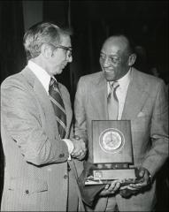 Thumbnail of Jesse Owens shakes hands with NCAA President Alan Chapman, 1974