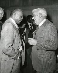 Thumbnail of Jesse Owens talking with a man at the NCAA Honors Luncheon banquet, 1974