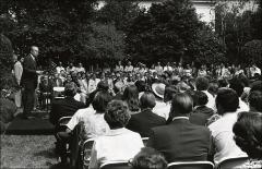 Thumbnail of President Gerald Ford gives a speech with Jesse Owens sitting to his left, 1976