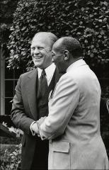 Thumbnail of President Gerald Ford shaking hands with Jesse Owens, 1976
