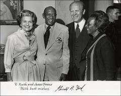 Thumbnail of An autographed photo of President Gerald and Betty Ford with Jesse and Ruth Owens, 1976