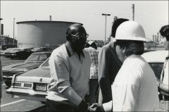 Thumbnail of Jesse Owens meets a worker from ARCO in a parking lot, 1978