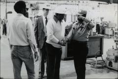 Thumbnail of Jesse Owens meets ARCO workers inside their factory, 1978