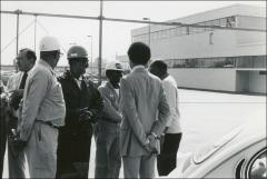 Thumbnail of Jesse Owens mingles with ARCO factory workers outside of the building during a visit, 1978