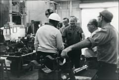 Thumbnail of Jesse Owens meets ARCO factory working at their stations during a visit, 1978
