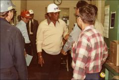 Thumbnail of Jesse Owens in a conversation with workers at an ARCO factory, 1978