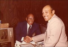 Thumbnail of Jesse Owens shakes hands with Carl Stokes, Mayor of Cleveland, 1979