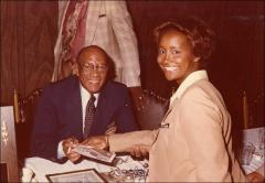 Thumbnail of Jesse Owens signs an autograph for a woman at the Motor City Traffic Club ceremony, 1979