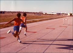 Thumbnail of Two runners practice on the track for the ARCO Jesse Owens Games, 1970s