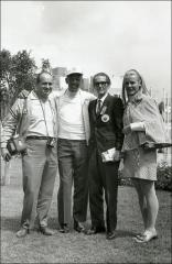 Thumbnail of Jesse Owens poses with a group, Mexico City Olympics, 1968