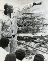 Thumbnail of Jesse Owens points towards a track, 1970s