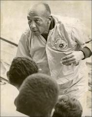Thumbnail of Jesse Owens talks with young runners, 1970s
