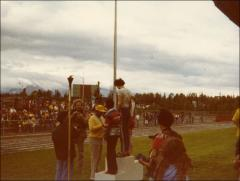 Thumbnail of Jesse Owens presents medals to young runners, 1970s