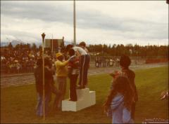 Thumbnail of Jesse Owens gives medals to young runners at a track meet, 1970