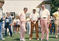 Thumbnail of Jesse Owens poses with golfers during an outing, 1970s