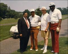 Thumbnail of Jesse Owens poses for a group photo with other golfers, 1970s