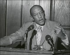 Thumbnail of Close-up of Jesse Owens speaking at an event, 1970s
