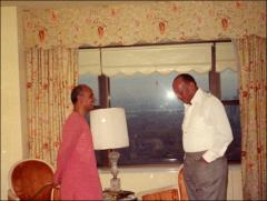Thumbnail of Jesse Owens talks with Sri Chinmoy in a room, 1970s