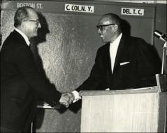 Thumbnail of Jesse Owens shakes hands with an unknown man, Quantico, VA, 1968