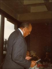 Thumbnail of Jesse Owens holds a plaque, 1976
