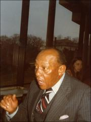 Thumbnail of Jesse Owens talks in a restaurant, 1976