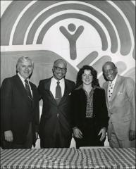 Thumbnail of Ed Janis, Paul Phillips, Meg Miller and Jesse Owens pose for a photo, 1975
