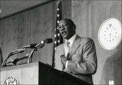 Thumbnail of Close-up of Jesse Owens delivers a speech at an event, 1970s