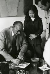 Thumbnail of Jesse Owens gives an autograph, 1970s