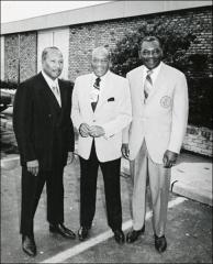 Thumbnail of Jesse Owens gets a picture with two men, 1970s