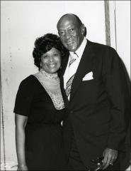 Thumbnail of Jesse Owens poses with an unidentified woman, 1970s