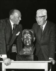 Thumbnail of Jesse Owens presents Larry Snyder with a bust of his likeness, 1968