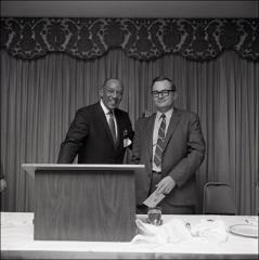 Thumbnail of Jesse Owens and an unknown man at a Franklin County Alumni Club event, 1969
