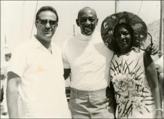 Thumbnail of Jesse Owens smiles during a group photo with Ruth Owens and an unidentified man in Greece, 1969