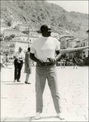 Thumbnail of Jesse Owens looks off into the distance in Greece, 1969