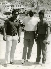 Thumbnail of Jesse Owens takes a photo with two men during a trip in Greece, 1969