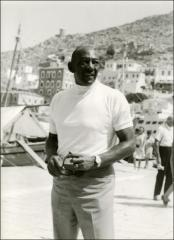 Thumbnail of Jesse Owens poses for a photo during his trip to Greece, 1969