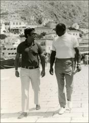 Thumbnail of Jesse Owens has a conversation along the harbor in Greece, 1969