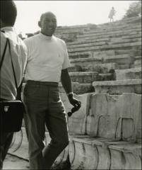 Thumbnail of Jesse Owens observes ancient ruins in Greece, 1969