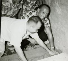Thumbnail of Jesse Owens presses his hands in wet cement, Philippines, circa 1950s