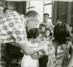 Thumbnail of Jesse Owens works with girls, Philippines, circa 1950s