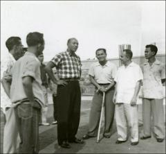 Thumbnail of Jesse Owens speaks to a group of unknown men, Philippines, circa 1950s