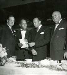 Thumbnail of Jesse Owens with Archibald Carey, Jr. and two unknown men at a re-election event, circa 1950s