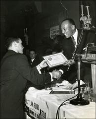 Thumbnail of Jesse Owens hands out Amateur Athletic Union National Award, 1954