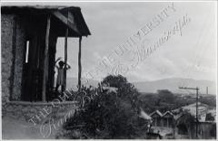 Thumbnail of Girl standing on front porch