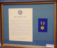 Thumbnail of Department of Defense Medal for Distinguished Public Service presented to John Glenn by Secretary of Defense William Cohen